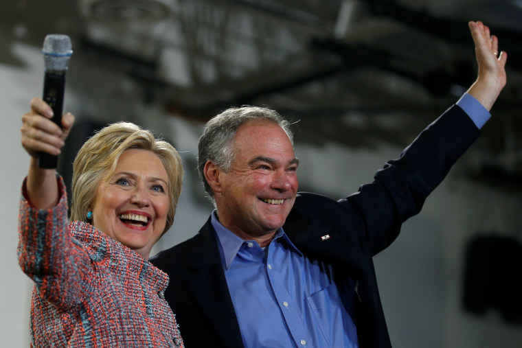 Image: Democratic U.S. presidential candidate Hillary Clinton and U.S. Senator Tim Kaine (D-VA) wave to the crowd during a campaign rally at Ernst Community Cultural Center in Annandale