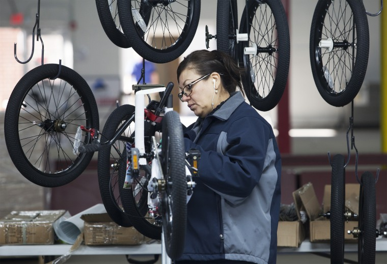 Nancy Bocanegra of Sumter, South Carolina installs brake cables at the new Bicycle Corporation of America plant in Manning, South Carolina