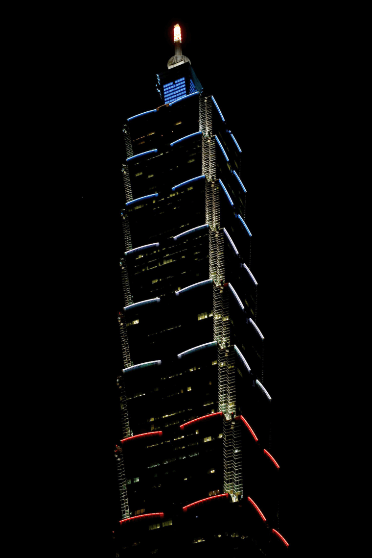 Image: Taiwan's landmark building Taipei 101 is lit up in the colours of the French flag
