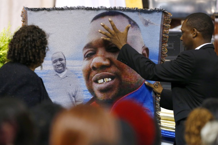 Image: Mourners pay their respects as they attend the funeral of Alton Sterling, in Baton Rouge