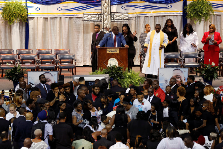 Image: Friends and family attend the funeral of Alton Sterling, in Baton Rouge, Louisiana