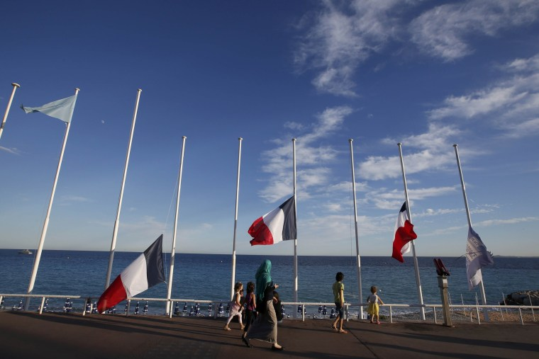 Image: French flags fly at half-mast in memory of victims the day after a truck ran into a crowd at high speed killing scores and injuring more who were celebrating the Bastille Day national holiday, in Nice