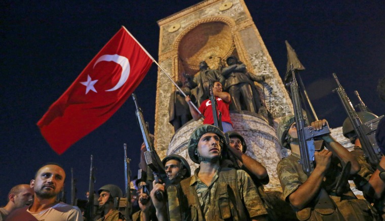 Image: People demonstrate in front of the Republic Monument at the Taksim Square in Istanbul