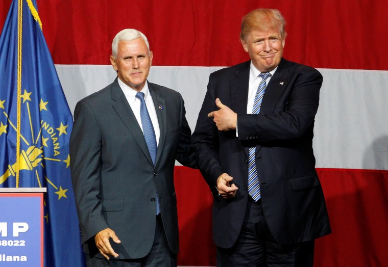 Image: Republican presidential candidate Donald Trump and Indiana Governor Mike Pence wave to the crowd before addressing the crowd during a campaign stop at the Grand Park Events Center in Westfield