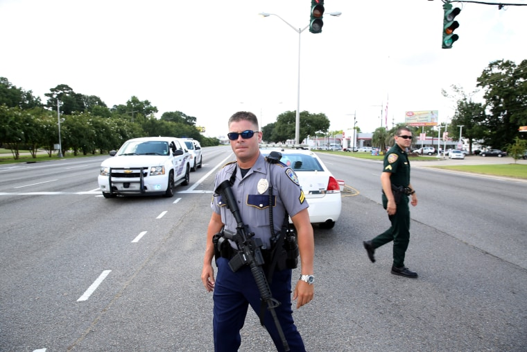 Image: Police officers block off a road after a shooting of police in Baton Rouge