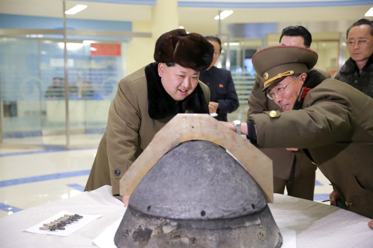 Image: North Korean leader Kim Jong Un looks at a rocket warhead tip after a simulated test of atmospheric re-entry of a ballistic missile