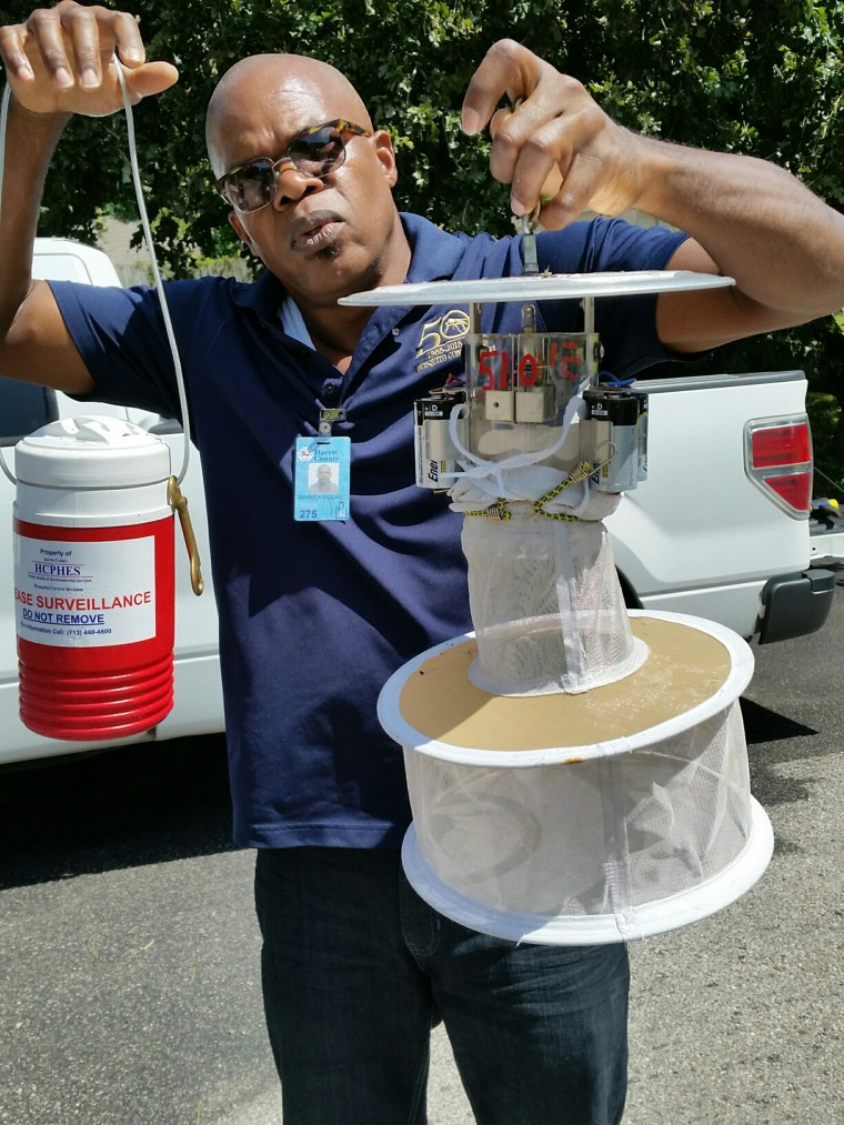 Maximea Vigilant, a surveillance entomologist for Harris County, Texas, checks a mosquito trap in Houston.