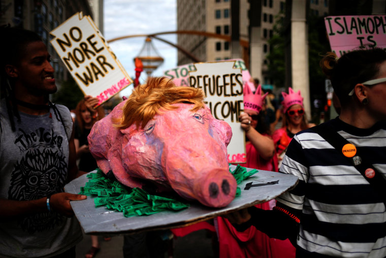 Image: Activists carry a prop during protest march by various groups ahead of Republican National Convention in Cleveland, Ohio