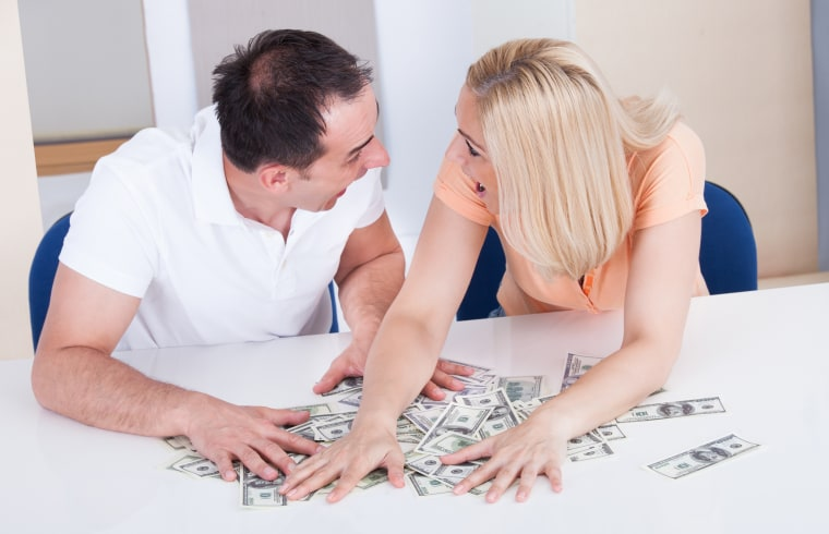 Image: A couple counting money