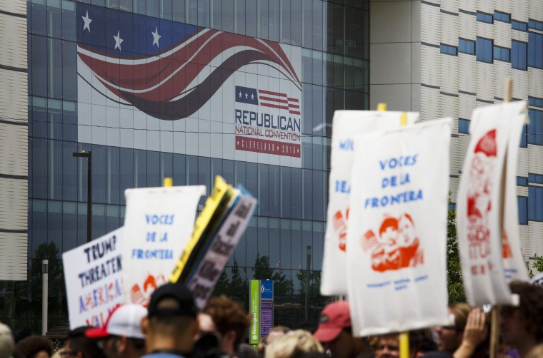 People march to protest the Republican National Convention and presumptive nominee Donald Trump in Cleveland, Ohio, USA, 18 July 2016.
