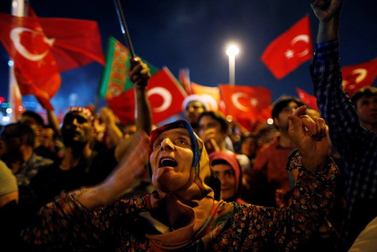 Image: Supporters of Turkish President Tayyip Erdogan attend a pro-government demonstration on Taksim square in Istanbul