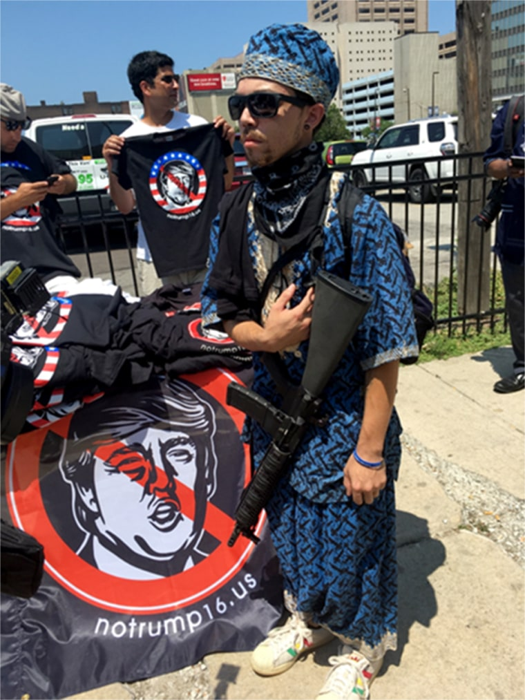 A man carrying AR-15 style weapons in Cleveland outside of the Republican National Convention. Three officers were monitoring, but allowing the man to continue.