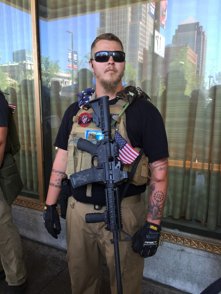 """Trevor Lees, 23, of the West Ohio Minutemen, a """"constitutional militia,"""" joined a half-dozen members of his group across from Public Square, taking advantage of Ohio's open carry provision to display his Smith and Wesson M&P 15 rifle."""