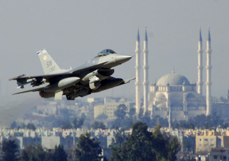 A U.S. Air Force F-16C Falcon fighter takes off from Incirlik air base with the Sabanci mosque in the background, near the southern Turkish city of Adana, Friday Jan. 24, 2003, for a daily mission over the no-fly zone in northern Iraq.