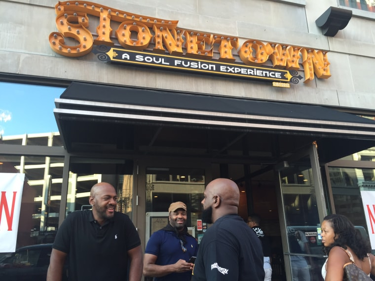 Patrons gather outside Stonetown, a soul food restaurant in Cleveland.