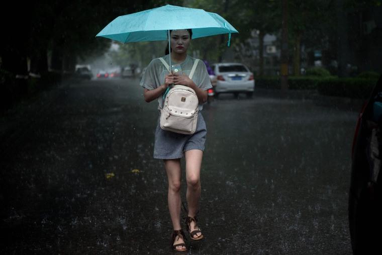 Image: TOPSHOT-CHINA-WEATHER-RAIN