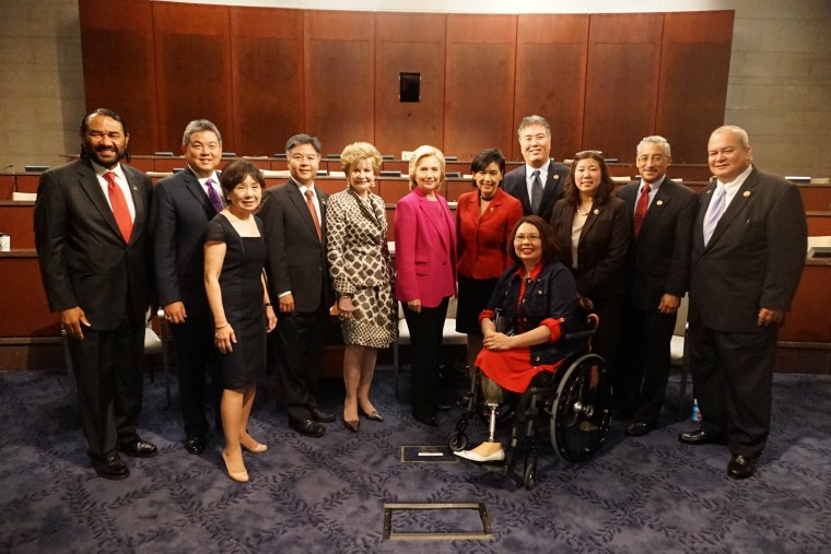 Rep. Mark Takai and CAPAC members with Hillary Clinton