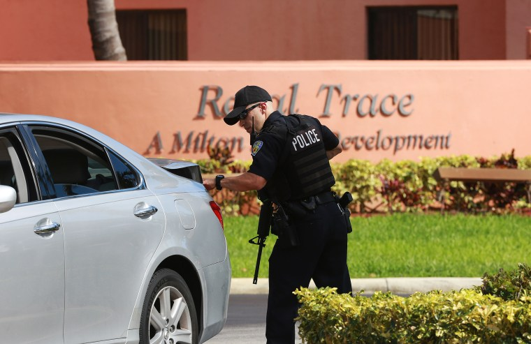 Authorities search Regal Trace apartment complex for Dayonte Resiles after he escaped from the Broward County Courthouse, Friday, July 15, in Fort Lauderdale, Fla.