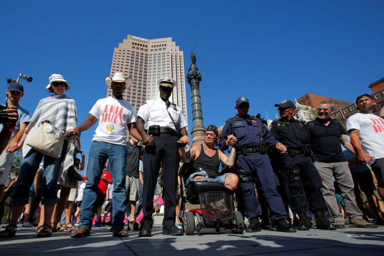 Image: Cleveland police chief Calvin Williams joins a prayer circle in Public Square outside the Republican National Convention in Cleveland, Ohio