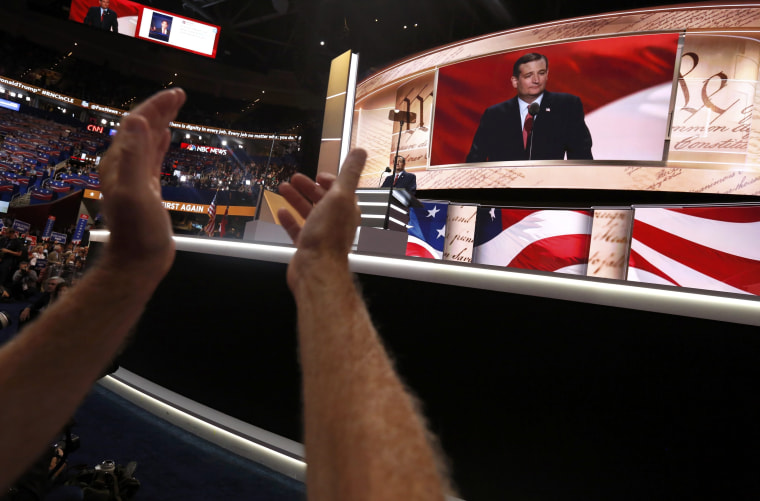 Image: A delegate applauds the speech of former Republican U.S. presidential candidate Senator Ted Cruz at the Republican National Convention in Cleveland