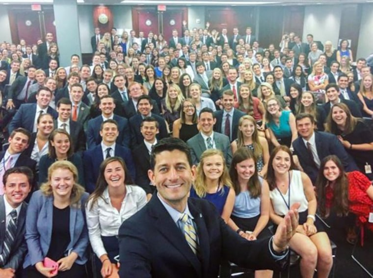 House Speaker Paul Ryan poses with Republican interns.