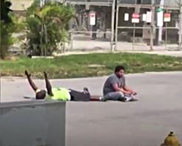 A cell phone video shows the moments before a South Florida caregiver was shot by a North Miami Police office as he was trying to calm an autistic patient.