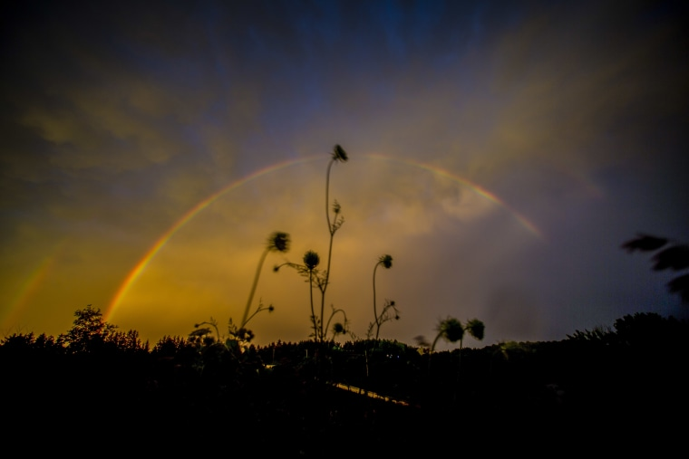 A double rainbow appears at sunset on Thursday, July, 21, 2016 in Saukville, Wis.