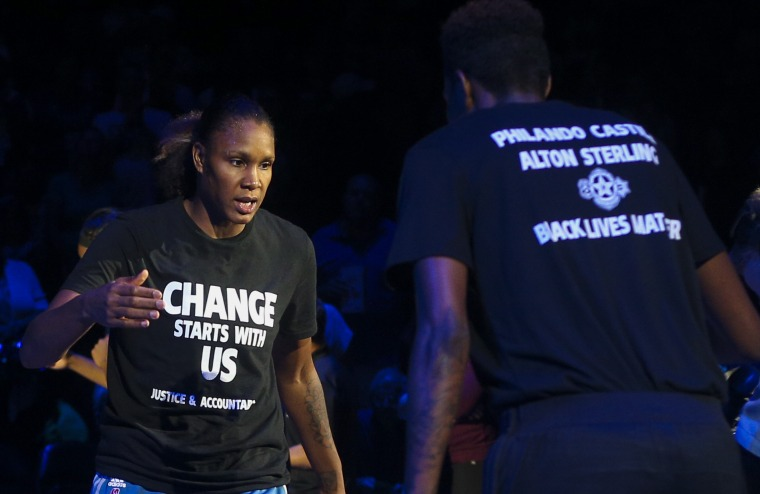 Minnesota Lynx forward Rebekkah Brunson, 32, is greeted by Minnesota Lynx forward Natasha Howard while starting lineups are announced at the Target Center on Saturday, July 9. Lynx players did not wear T-shirts supporting the Black Lives Matter movement ahead of Tuesday's game in San Antonio after four off-duty police officers walked away from security jobs at a Lynx game over the weekend because of the T-shirts.
