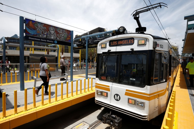 Image: A train is seen on L.A. Metro's new $1.5 billion Expo Line extension that connects downtown to the beach in Santa Monica