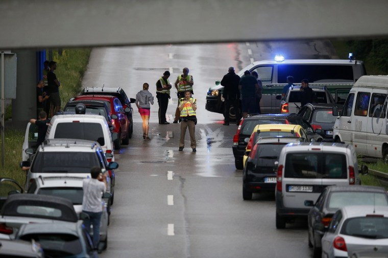 Image: Police halt traffic on road near to scene of a shooting rampage in Munich