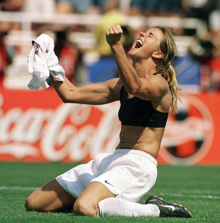 Brandi Chastain celebrates by taking off her jersey after kicking in the game-winning penalty shootout goal against China in the Women's World Cup Final at the Rose Bowl in Pasadena, California, in 1999.