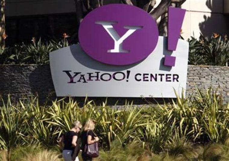 Women walk past Yahoo office in Santa Monica