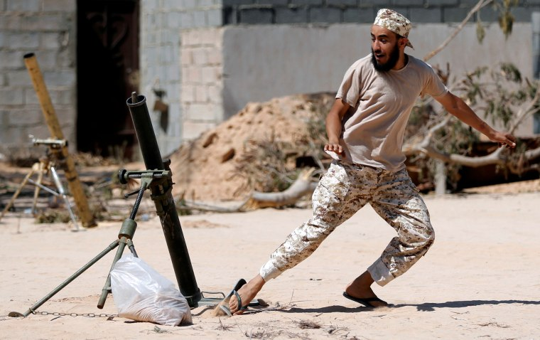 Image: A fighter of Libyan forces allied with the U.N.-backed government fires a 81 mm mortar round in Sirte