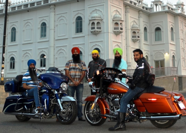 Members of the Sikh Motorcycle Club pose for a photo during a cross-country trip to raise money for pediatric cancer.