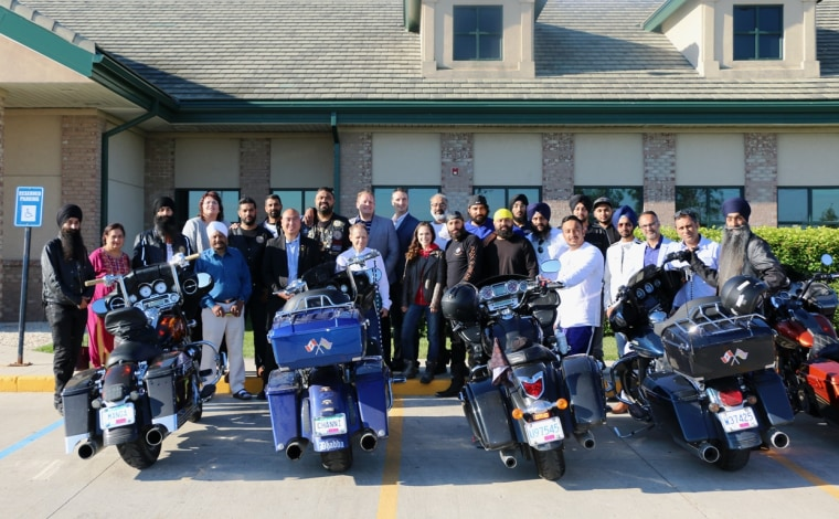 Members of the Sikh Motorcycle Club pose for a photo during a cross-country trip raising money for cancer awareness.
