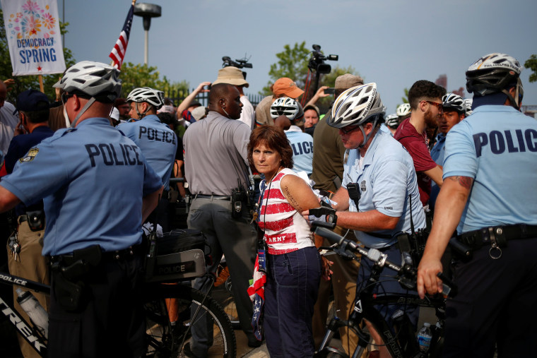 Image: An activist is arrested outside the site of the 2016 Democratic National Convention in Philadelphia, Pennsylvania