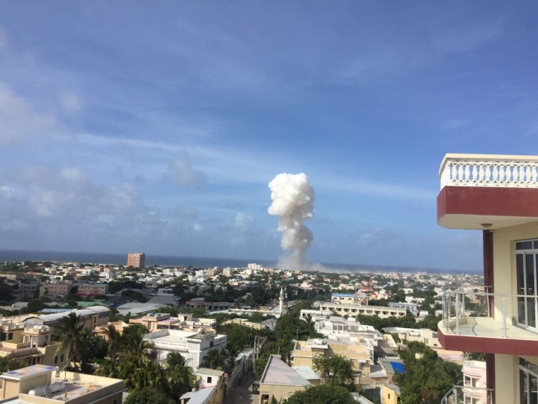 Image: Smoke rises after bomb blasts near the main entrance of the airport in Mogadishu on July 26, 2016.