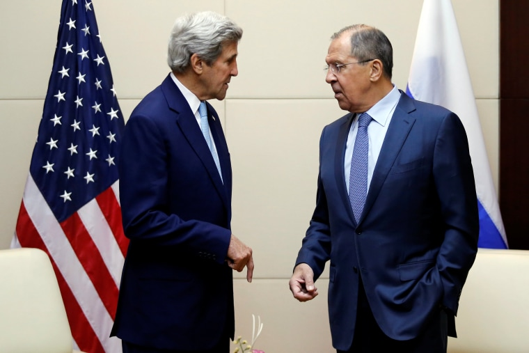 Image: U.S. Secretary of State John Kerry meets Russia's foreign minister Sergey Lavrov during a bilateral meeting at the sidelines of the ASEAN foreign ministers meeting in Vientiane