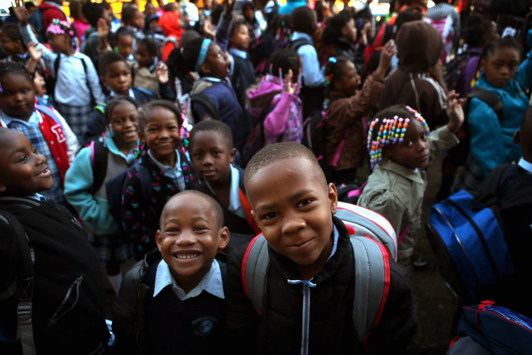 Students at Frazier International Magnet School wait outside before the start of school on September 19, 2012 in Chicago, Illinois.