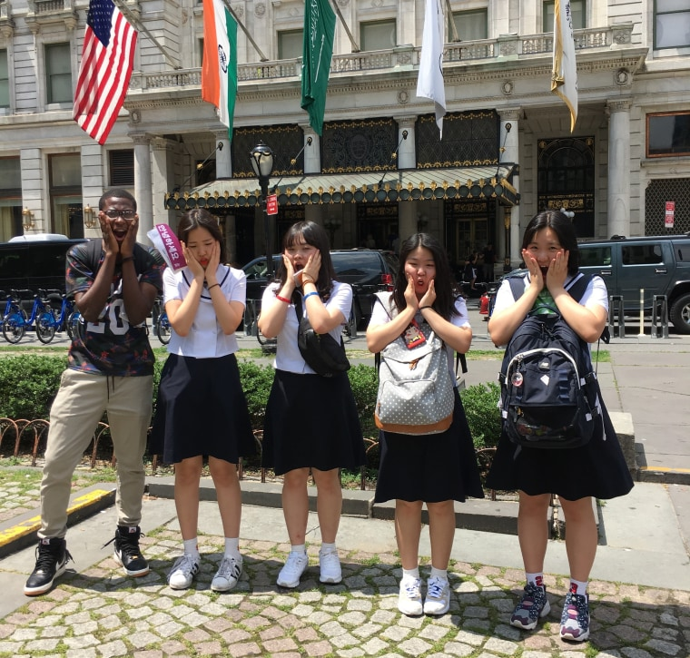 "Democracy Prep and Seondeok Girls' High School students strikes a ""Home Alone"" pose in front of the Plaza Hotel."