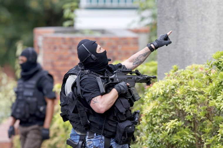 Image: Members of French special police forces of Research and Intervention Brigade (BRI) are seen at the scene during a raid after a hostage-taking in the church in Saint-Etienne-du-Rouvray