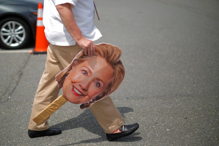 Image: A man carries a cardboard cutout of the face of U.S. Democratic presidential candidate Hillary Clinton outside the Democratic National Convention in Philadelphia