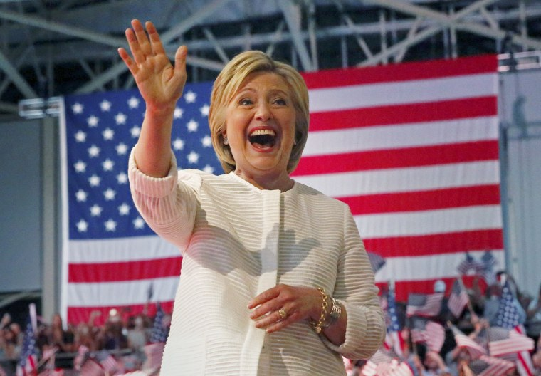 Image: Democratic U.S. presidential candidate Hillary Clinton waves during her California primary night rally held in the Brooklyn borough of New York