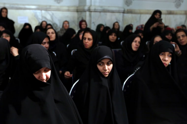 Image:  Iranian women attend a meeting on Feb. 23