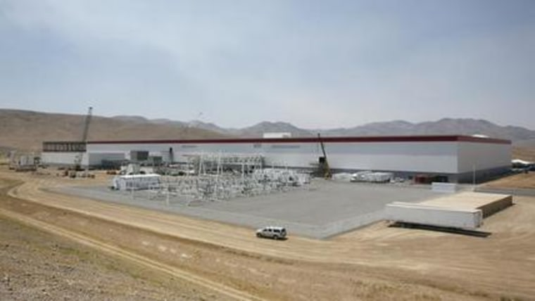 An overall view of the new Tesla Gigafactory is seen during a media tour Tuesday, July 26, 2016, in Sparks, Nev. It i??s Tesla Motors'?? biggest bet yet: A massive, $5 billion factory in the Nevada desert that could almost double the world???s production of lithium-ion batteries by 2018. (AP Photo/Rich Pedroncelli)