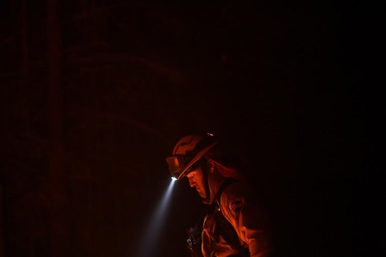 Image: Firefighter Brendon Gorman pauses while battling the Soberanes Fire along Palo Colorado Road near Big Sur