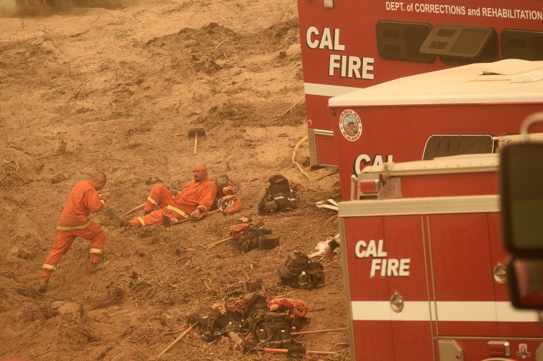 Image: Inmate firefighters rest before constructing a fire break to stop the Soberanes Fire in Carmel Highlands