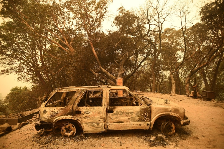 Image: A burned car rests in the driveway of a Palo Colorado area residence leveled by the Soberanes Fire near Big Sur