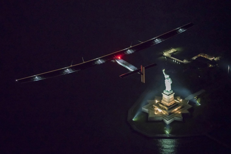 Image: Solar Impulse 2, the solar airplane, piloted by Swiss adventurer Andre Borschberg, flies over the Statue of Libery in in New York, shortly before landing at John F. Kennedy airport