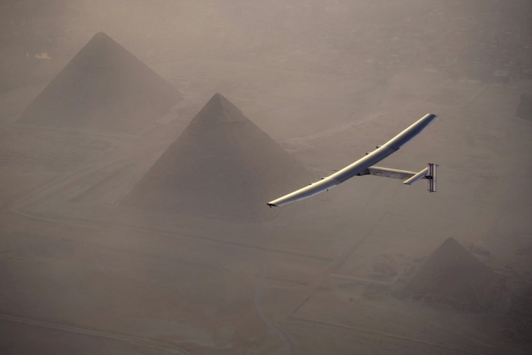Image: Solar Impulse 2, the solar powered plane, piloted by Swiss pioneer Andre Borschberg is seen during the flyover of the pyramids of Giza on July 13, 2016 prior to the landing in Cairo